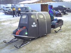 Looks like Mercury or Scorpion sled with homemade shelter. OUGLY... but looks warm.