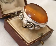 A personal favourite from my Etsy shop https://www.etsy.com/listing/236353370/vintage-silver-baltic-amber-beautiful
