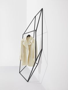 les ailes noires clothing display by john tong