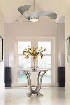 Innovative modern art that also creates a cool breeze, the eye catching Torto from Fanimation is the perfect center piece for any contemporary room.