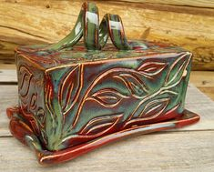 Item: One Rectangular butter dish w/ hand carving Glaze finish: Firebrick w/ Deep Sea Overlay Specifications: Microwave, dishwasher, oven & food safe & 100% lead free. ♥ ♥ ♥ GIFT PURCHASES - if youre purchasing this as a gift, were happy to ship directly to the recipient with a