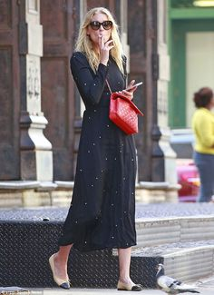 Smokin'! The 27-year-old model wore a pretty prairie style midi dress with flats on the outing