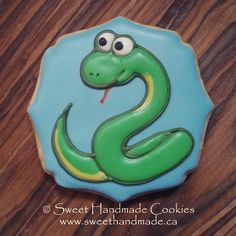 This might be the cutest snake I have ever seen!  Yummy too!  #sweethandmadecookies #customcookies #cookies #delicious #decoratedcookies #love #cute #snake #snakecookies #animalcookies #designercookies