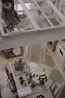 Salvaged window suspended in the rafters.
