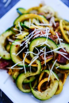 Summer Squash Zoodles with Bacon - zucchini, yellow squash, salt, bacon, red onion, ACV, grated Italian 3-cheese blend (optional, might sub Parmesan)