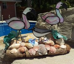 Check out this item in my Etsy shop https://www.etsy.com/listing/294832531/stained-glass-flamingos-wading-in