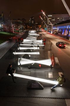 Canadian firms CS Design and Lateral Office worked in collaboration to create this incredible public art installation comprised of 30 illuminated seesaws. When used, the seesaws are activated and begin to emit musical tones.  More art on the grid via Colossal