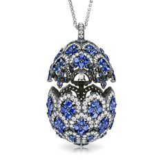 ZénaÏde Sapphire Egg Pendant Locket  Les Favorites de Fabergé    One of a series of three exceptional Fabergé egg locket pendants, designed in the graphic style of traditional Uzbek textiles, and named for the Princess ZénaÏde Yusupov, a favourite of the Imperial family and the mother of Prince Felix, heir to the Yusupov fortune and murderer of Grigorii Yefimovich Rasputin. This egg, in white gold, black rhodium-plated to create an antique-style patina.