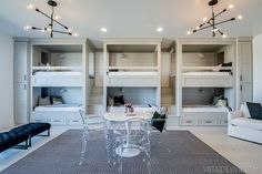 separate one full/twin bunk per wall; third wall window. Game table in center of room