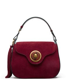 Bold in burgundy: the Tassel Large Shoulder Bag from our fall runway — in a key color of the season