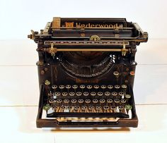 typewriter - I have something similar to this, Jessica. Since hubby = editor and I came from a writing background, could be a fun prop?