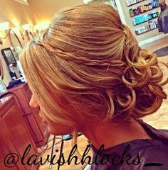 curly updo with a bouffant and braid