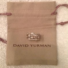 David Yurman Diamond Confetti Stack Ring Authentic David Yurman Diamond Confetti Stack Ring. Originally size 6 but resized to size 8. Comes with pouch bag. I've updated the pictures!!! The DY sign has been rubbed off as it has been resized. No other guarantees. I'm the 2nd owner. 1st owner guaranteed authenticity. Thanks for looking! :) David Yurman Jewelry Rings