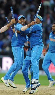 Rohit Sharma (L) and Suresh Raina celebrate #CT13 #Cricket