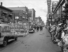 1930s - 1934 GRAND ARMY OF THE REPUBLIC CIVIL WAR VETERANS JOIN PARADE DOWN MAIN STREET DURING ROCHESTER NEW YORK CENTENNIAL  – Image © ClassicStock / Masterfile.com: Creative Stock Photos, Vectors and Illustrations for Web, Mobile and Print