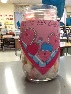 "February Behavior Idea! This glass jar is on my desk and is filled with yummy Valentine hearts. It says ""Love to see Good Behavior"". When I see a student or students with extra good behavior, I tell them they can get a candy heart from the jar. When the jar is EMPTY, the whole class gets to play a Valentine Game! They were so excited about it today!"