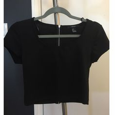 Black short sleeve crop top Simple and cute. Zipper in the back. Worn once. Short sleeves. Round neckline. Hits at the ribs. Forever 21 Tops Crop Tops