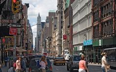 new york city neighborhoods | Bloomingdales is on the left in this busy New York City SoHo ...