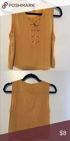 Mustard tank top with tie neck Crepe top in mustard.  It has a tie detail at the neckline.  From Forever 21. Forever 21 Tops Tank Tops
