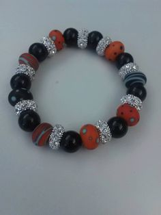 Orange and Black Polka Dot Lampwork Bracelet by SarahsCreativeExp on Etsy