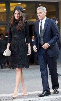 Amal cut a stylish figure in her sleek Versace ensemble as she accompanied her husband to ...
