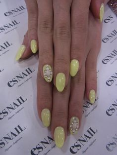 Pastel yellow nails. Minus the pearl designs tho. Not my style