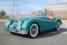 Why yes please, I will gladly take this 1956 Jaguar Roadster off your hands!