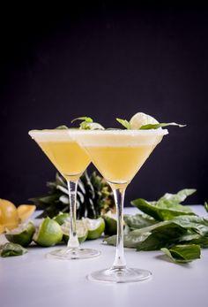 Pineapple-Basil Rum Fizz - Pineapple, Lime Juice, Basil Leaves, Light Rum, Club Soda, Sugar Rim.