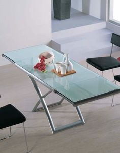 Extending Glass Table Fully Opened Up And Raised To Its Top Height, Ready  For You