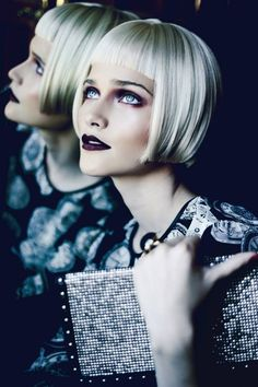 there must be a reason I keep coming back to images like this...sharp blunt bob, fringe...