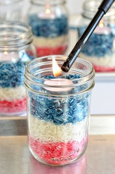 Patriotic Colored Rice Jars Candle centerpiece at TidyMom.net