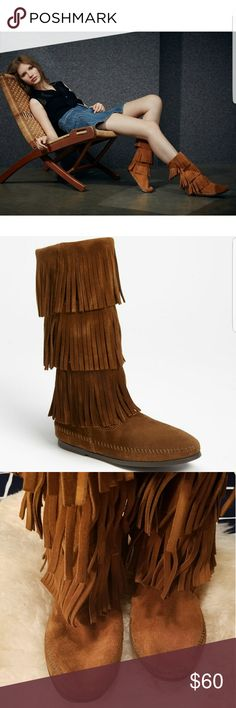 Minnetonka fringe boots Super cute fringe moccasin boots by Minnetonka. These boots are incredibly comfortable. Only worn a few times, I love them but now live in the Caribbean so they aren't getting any wear. They look great with cutoffs. No flaws, a little dirt on the toes, it looks darker in the picture than in person. You will love these boots! Minnetonka Shoes Moccasins