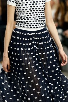 #Chanel Love that the little bow pattern also appears as polka dots. Win Win