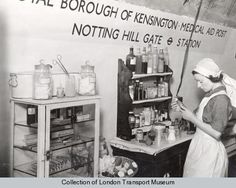 A nurse checks the contents of the medicine cabinet in a medical aid centre located in Notting Hill Gate Underground station, during the Second World War.