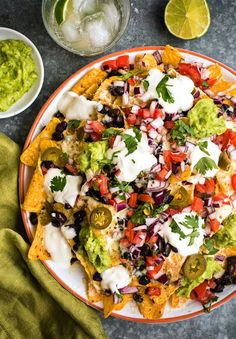 Fully loaded vegetarian nachos with homemade guacamole, fresh salsa, black beans and jalapenos.