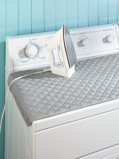 Quilted Ironing Mat Boards- the board cover sits on top of the dryer and saves so much space!