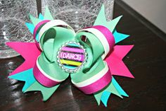 This hairbow is great for the little dancer in your house.  It's on a french barrett and has a bottle cap center with the words DANCE.  If you would like a special order bow please contact me and sydron2@gmail.com or on this site.