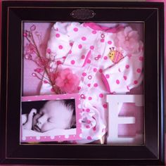 i wanted to make maddi & daws a shadow box like this with their 1st outfits that they went home in!!