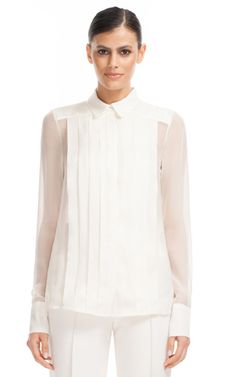 Front Placket Blouse. Placket: An opening or slit in a garment, covering fastenings or giving access to a pocket, or the flap of fabric under such an opening.    [Hanis Amani Binte Zainal FD1A1]