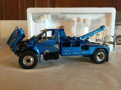 The First Gear Edition Ford F-650 Truck with Jeerdan Tow Body wrecker rear boom with box ( model No. 19-0033 ), F, color blue. The 1:34 scale, Diecast Model Replica Tow Truck has good detail, Item looks and displays good, will make a nice addition to your Toy Truck Collection!   eBay! Toy Trucks, Diecast Models, Color Blue, Gears, Cruise, Scale, Ford, Detail, Nice