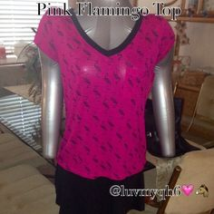 HP 2/10Pink Flamingo Print Top Flamingo Print short sleeve Top with pocket. It has black trim, on the V neck collar and zipper that is located on the back of the shirt. Color is dark hot pink with the black pattern of Flamingos. The material is 100% Rayon. Light weight soft, and flowy! Size Small. Black Skater's Skirt pictured with this shirt is not included. I am selling the skirt in another post in my closet! NWT HP 2/13 Xhilaration Tops