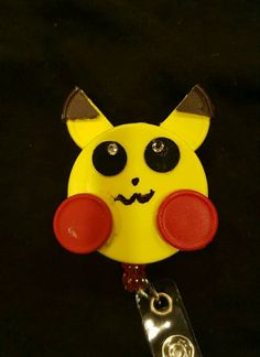 Check out this item in my Etsy shop https://www.etsy.com/listing/262011205/picachu-retractable-id-badge-holder-made