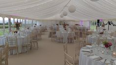 Paper lanterns with fairy lights in wedding Marquee by Pavilion