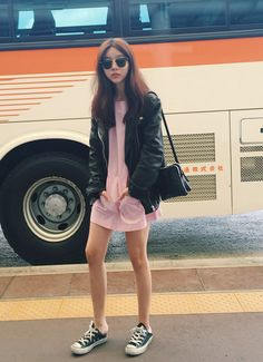 Cool and edgy outfit with the black leather jacket, black converse, black shoulder bag and the pink dress for a girly feminine touch