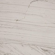 Mont Blanc quartzite is a white and grey natural stone suitable for kitchen bench tops and walls.