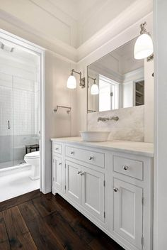 Bathroom features hardwood flooring in the vanity area and tile flooring in the shower area.  Lighting is Visual Comfort. Faucet and sink are Waterworks. Tiles are Walker Zanger.  Robyn Hogan Home Design.  Max Crosby Construction.