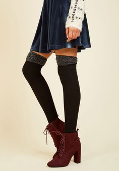 Seeking some oomph for your ensembles? These black thigh highs offer exactly that! Topping ribbed knit shafts, sparkling silver upper accents flaunt fun ruching and sweet scalloping - features that fulfill your fashion needs.