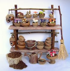 Dollhouse miniature shelves with bowls & cups made from acorn tops - broom made w/ stick & mini straw