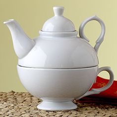 """""""A tea-lover's delight. This Tea-for-One Set showcases a classic teapot silhouette that includes the teacup as well as metal filter. Simply pour boiling water into pot, steep, and then enjoy out of matching cup."""" This is how to get the best-tasting tea if you're into tea leaves vs. bags. Which everyone should be."""