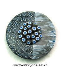TAD 23 Hollow lentil pendant by Cara Jane